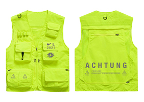 Utility vest in neon yellow, with many pockets from the strictly limited